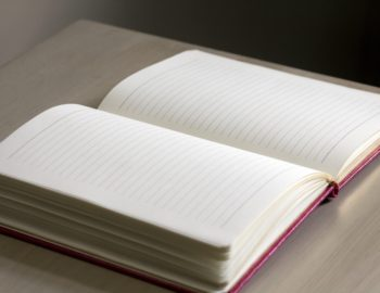 white-lined-notebook-on-gray-table-159768
